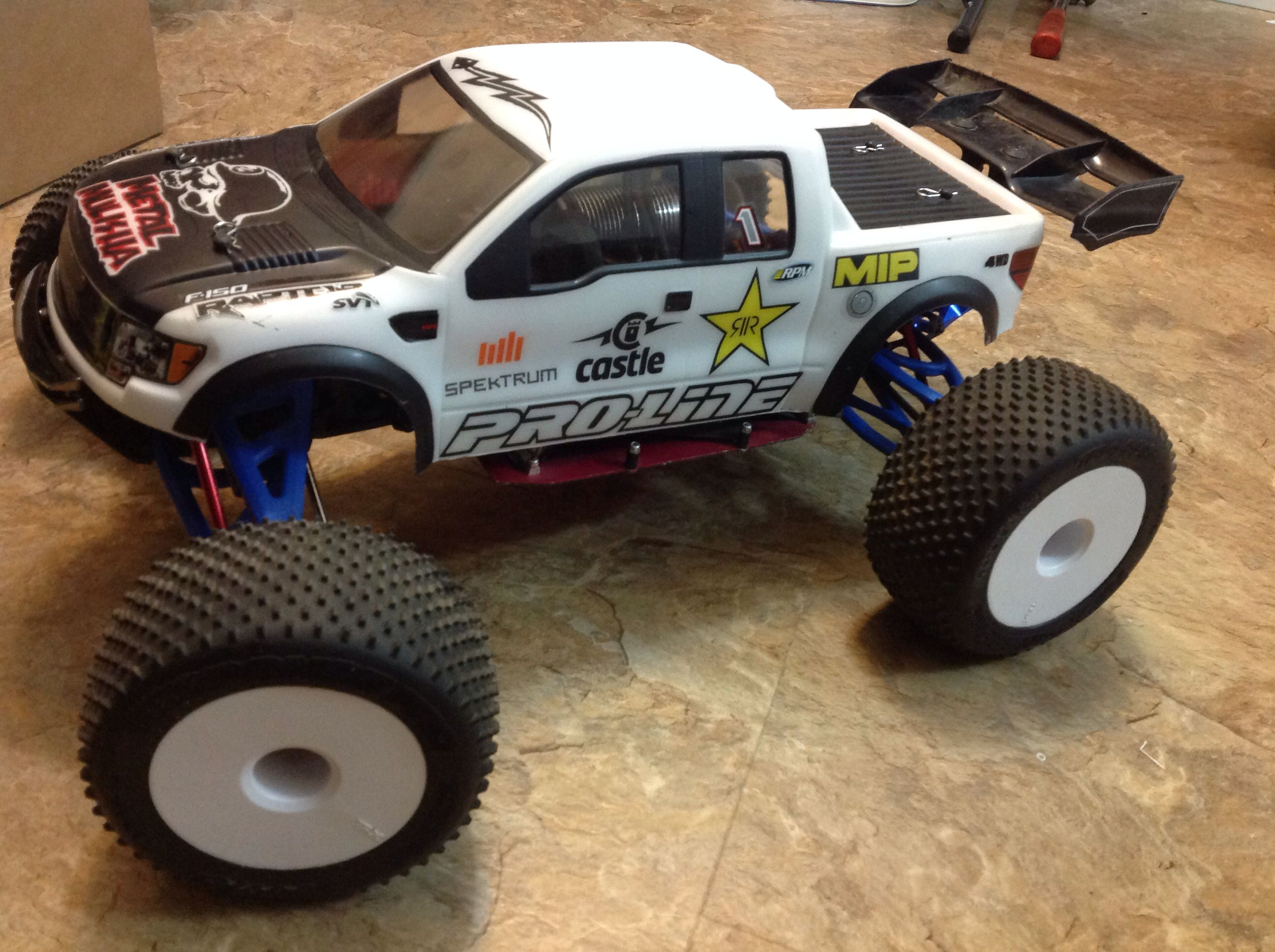 Traxxas E Revo Brushless Edition W upgrades ProLine racing Raptor SVT body