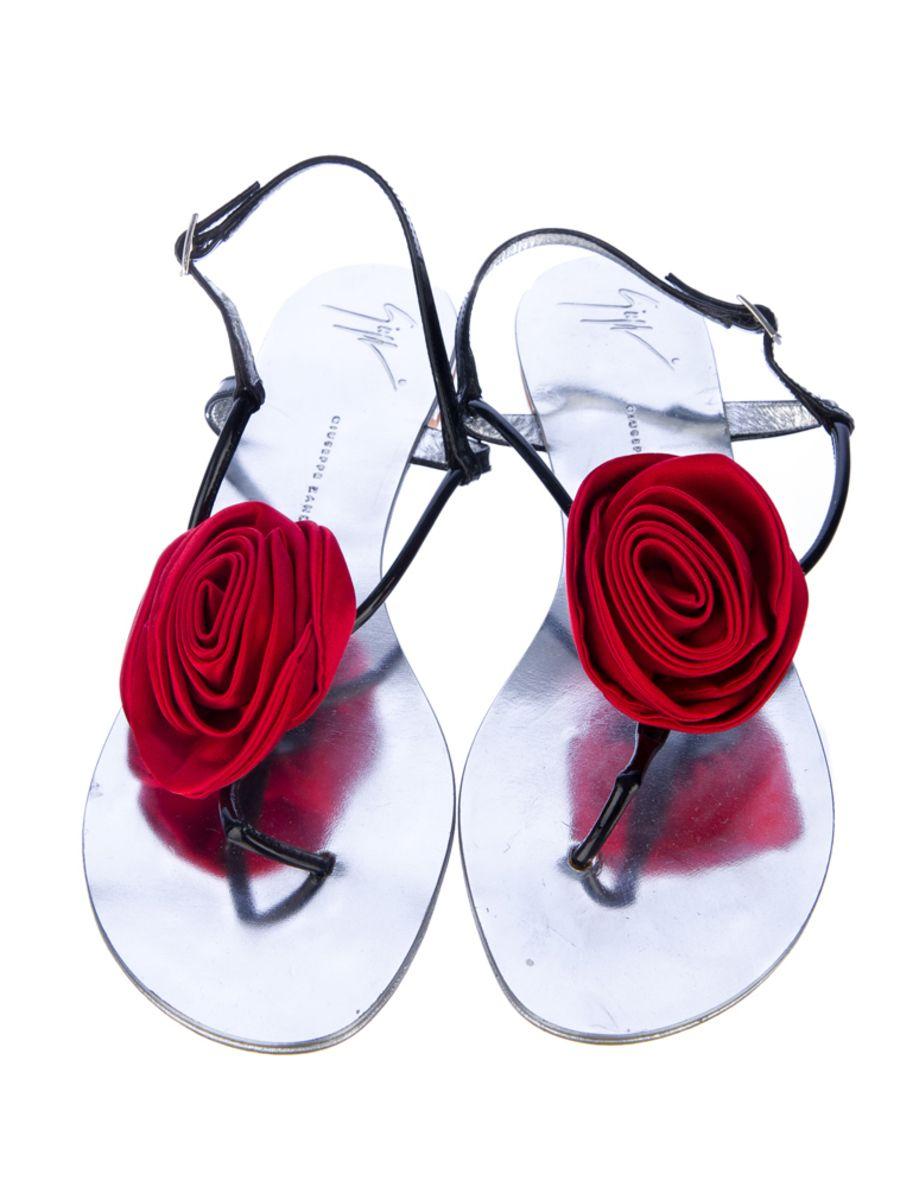 GIUSEPPE ZANOTTI SANDALS -  Giuseppe Zanotti patent sandals with eye popping red rosettes.