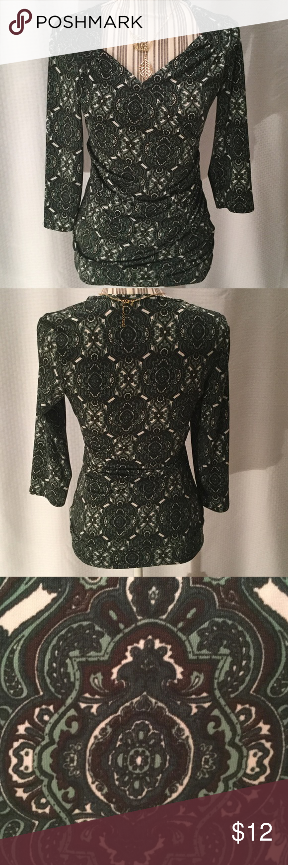 Beautiful Paisley blouse Maurice's brand. Size medium. Green, dark brown and white. Polyester/spandex blend. Faux wrap style. Very forgiving in the waist area. Looks great with a pair of brown dress pants. EUC. Maurices Tops Blouses