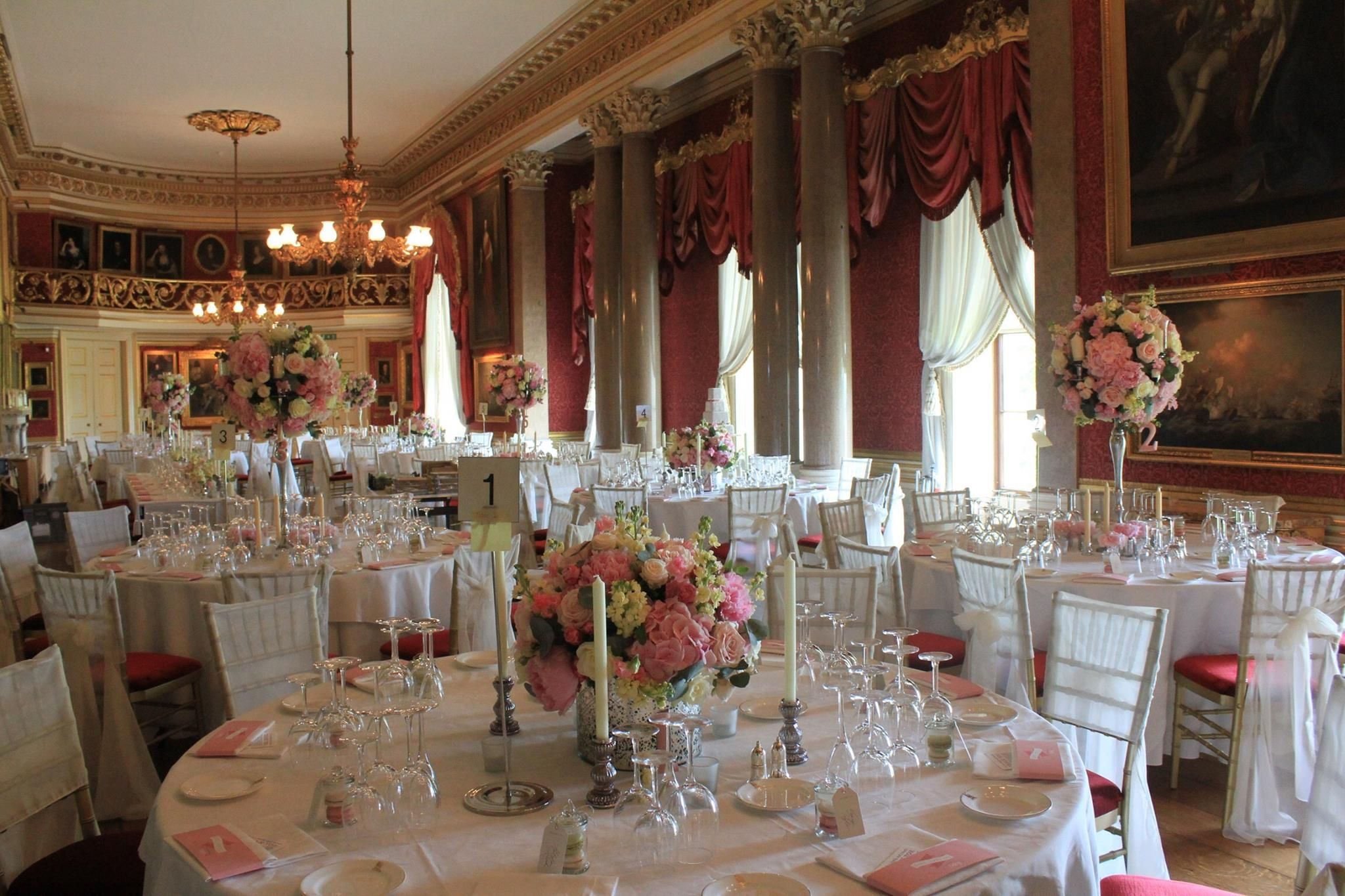 Wedding reception venue with the pale grey wedding cake set up at Goodwood House. Flowers by White Lilac florists (www.white-lilac.co.uk)