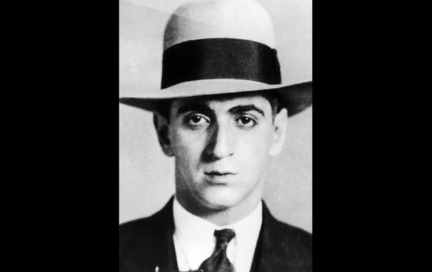 A hard stare emotes from the characteristically stern visage of American gangster and boxing manager Frank Carbo in 1936