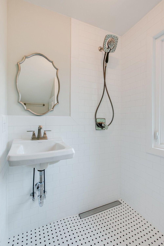 Amazing small bathroom with double barn door subway tile