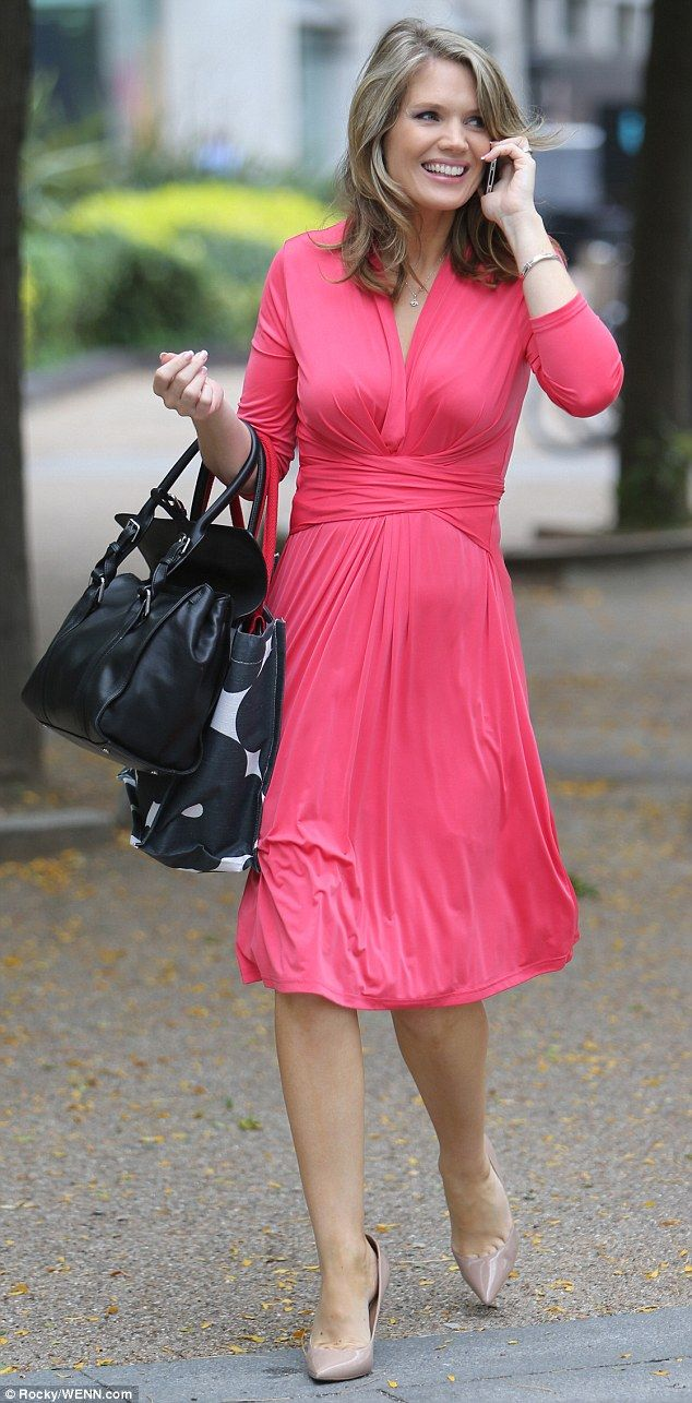 Pregnant Charlotte Hawkins displays bump in fitted dress outside ITV