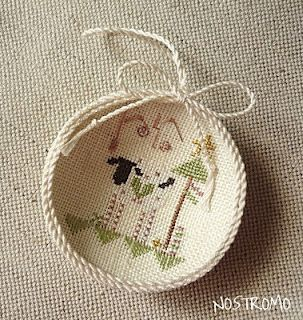 reverse hoop & place needlework picture inside.  Different presentation.