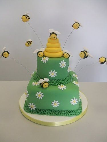 Bumblebees Flying Around A Cake