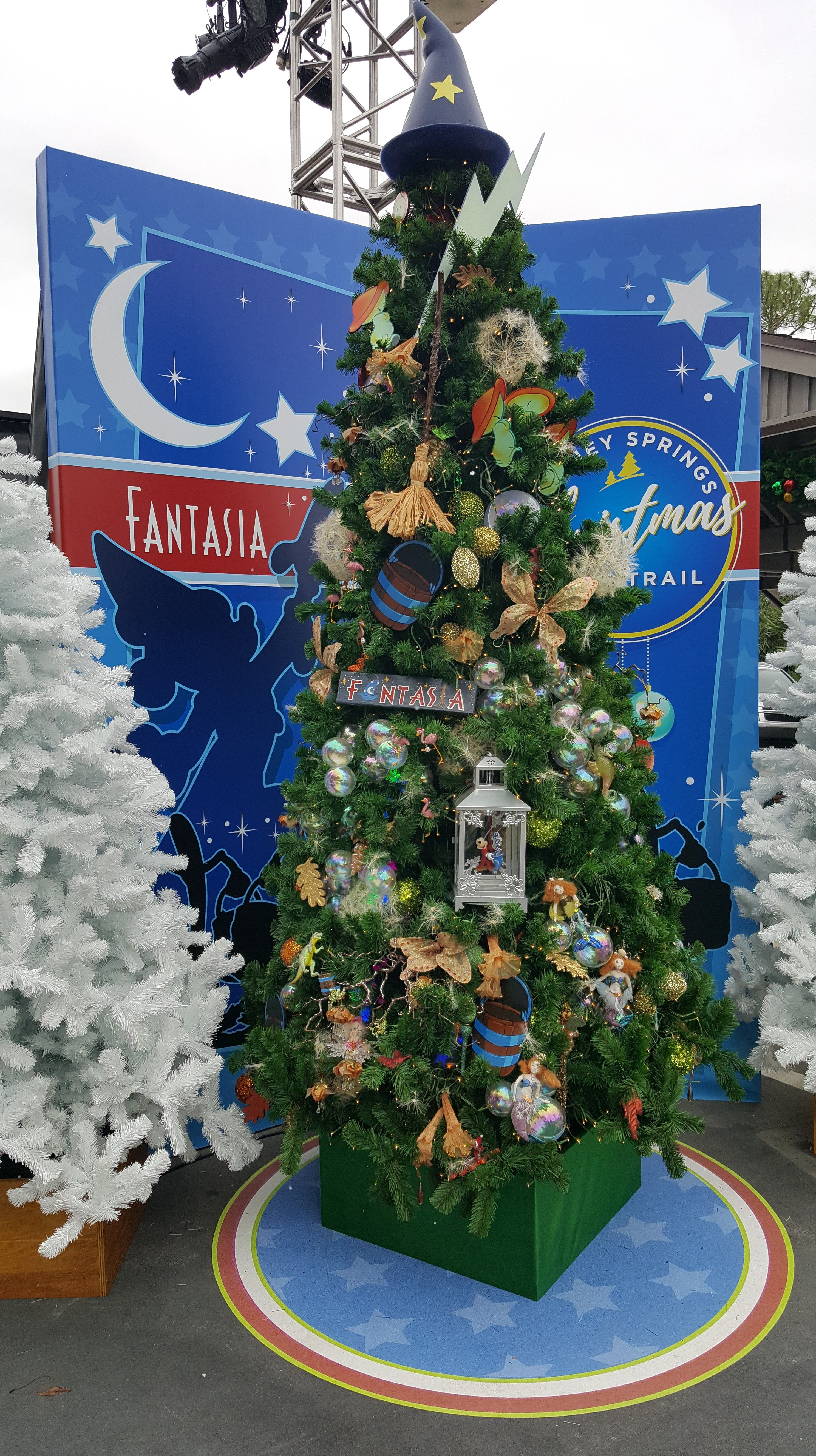 the disney springs christmas tree trail brings merriment to shopping
