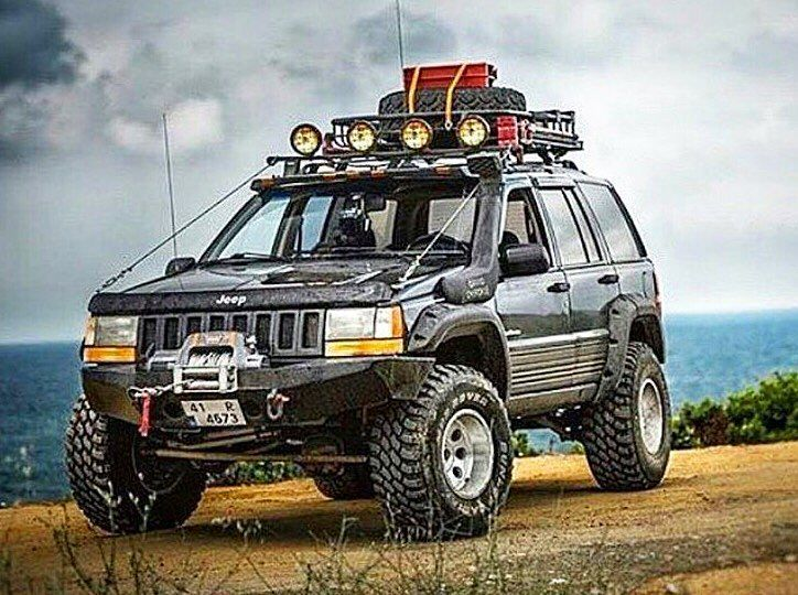 Wow This Grand Cherokee Is Built Up And Ready For The Trails Www Zimmermotors Com Jeep Zj Jeep Grand Cherokee Zj Jeep Cherokee