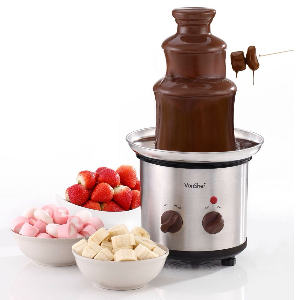 Chocolate fountain with strawberries,marshmallows and bananas ...