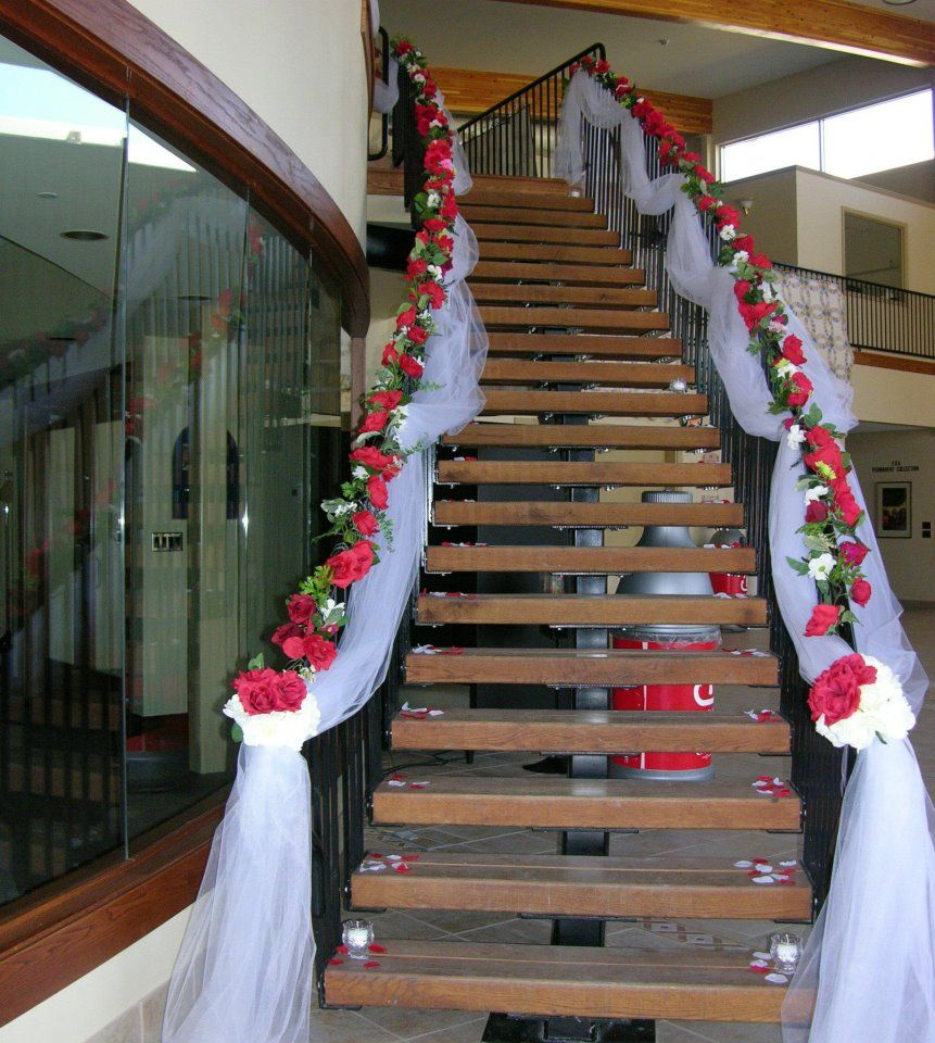 Stairway decorated with white tulle and red silk roses for Home wedding ideas