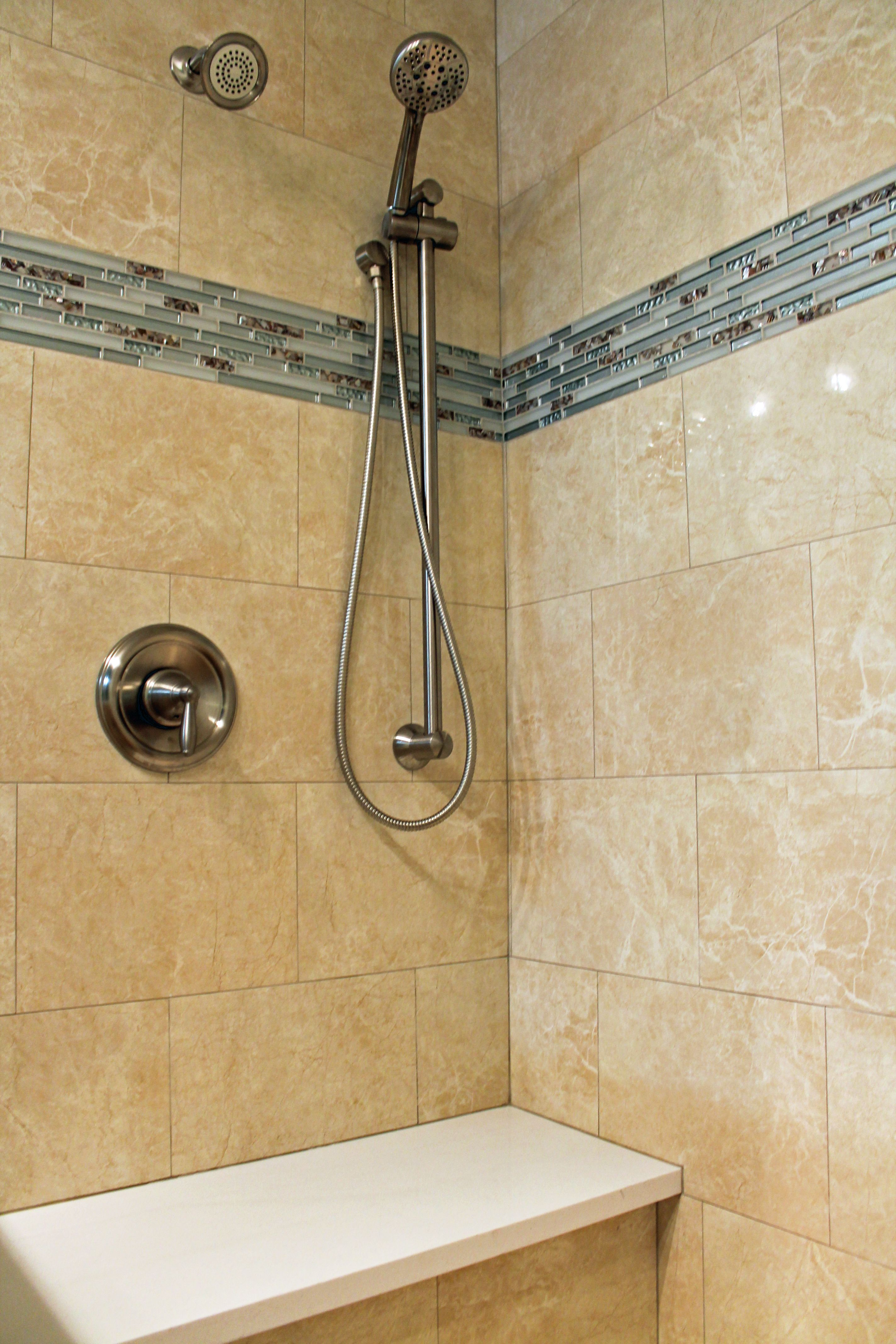 Shower design with beige wall tile and blue glass mosaic