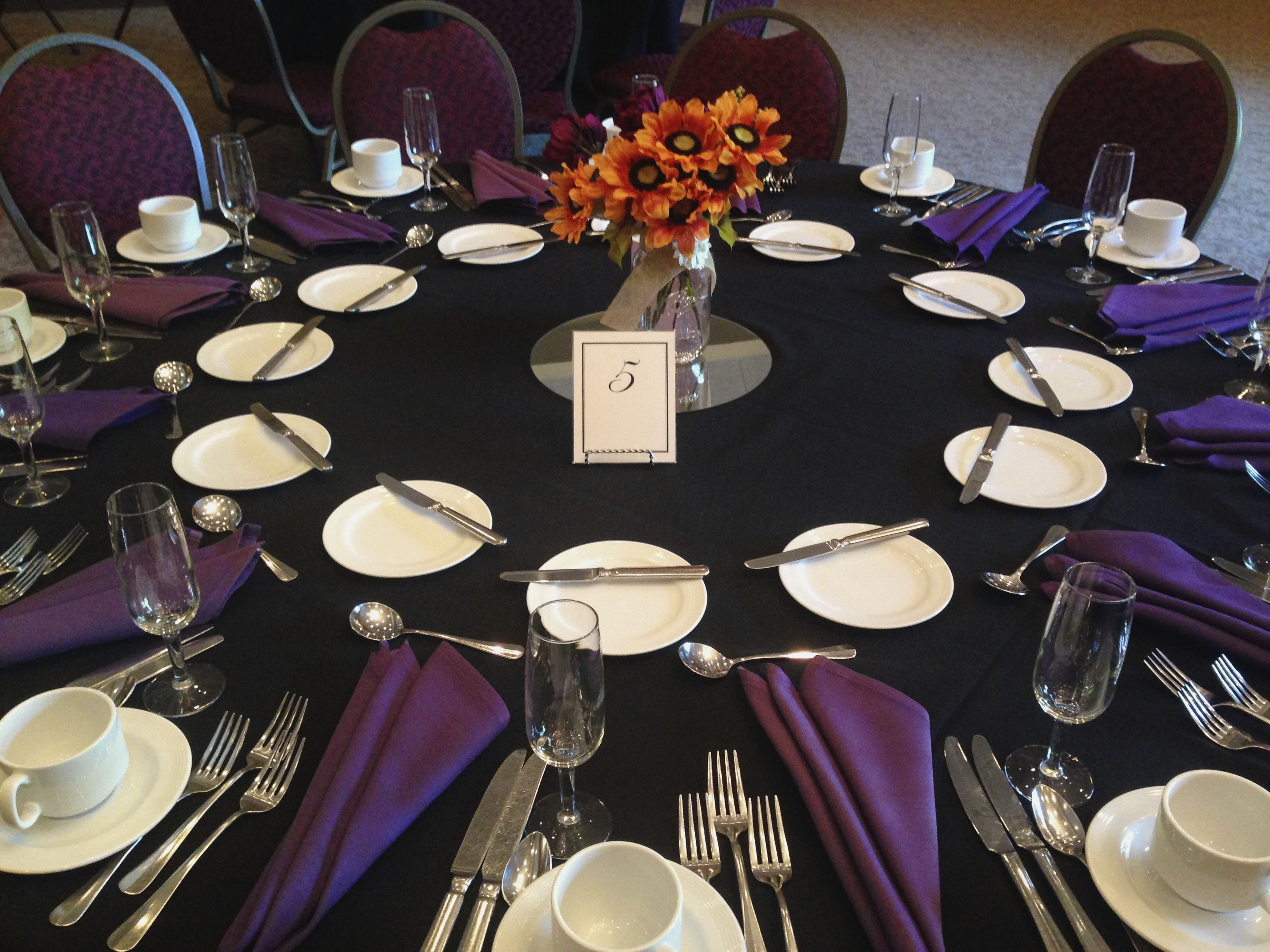 A Unique Wedding Black Tablecloths And Dark Purple Napkins