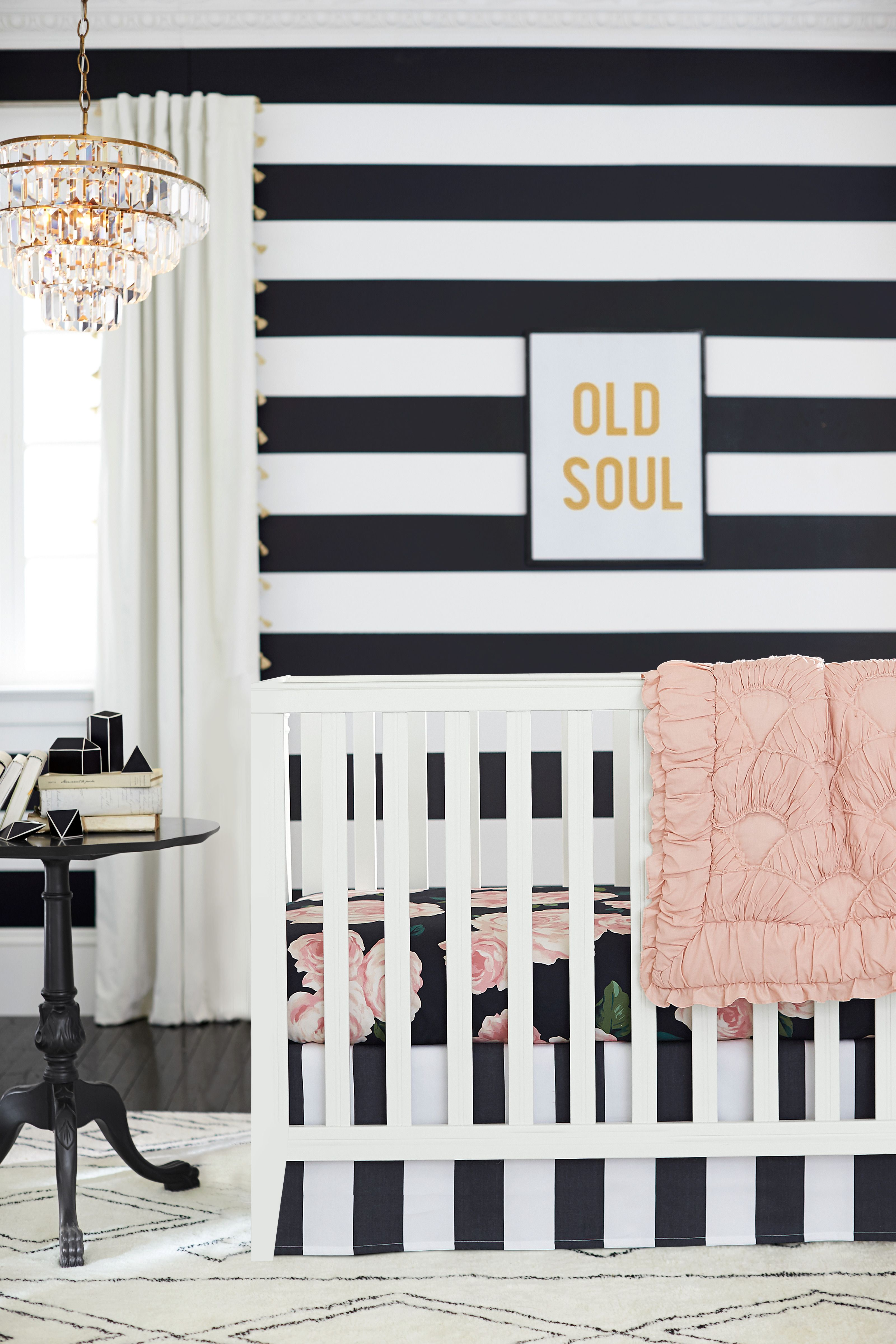 Emily Meritts Bed of Roses Nursery is black white and blush