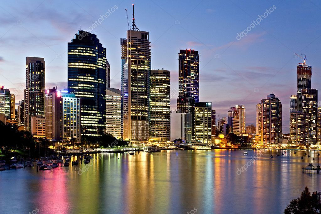 Brisbane city reflected in the river at sunset stock