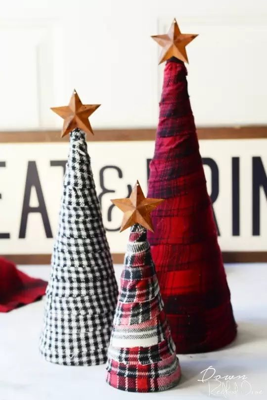 These fabric scrap flannel Christmas trees are a perfect DIY project. No sewing required. #christmas #christmastrees #christmasdecor #fabricscraps #diy #diydecor #diychristmasdecor #christmastreedecor #craftgossip Featured and reviewed on Craftgossip.com