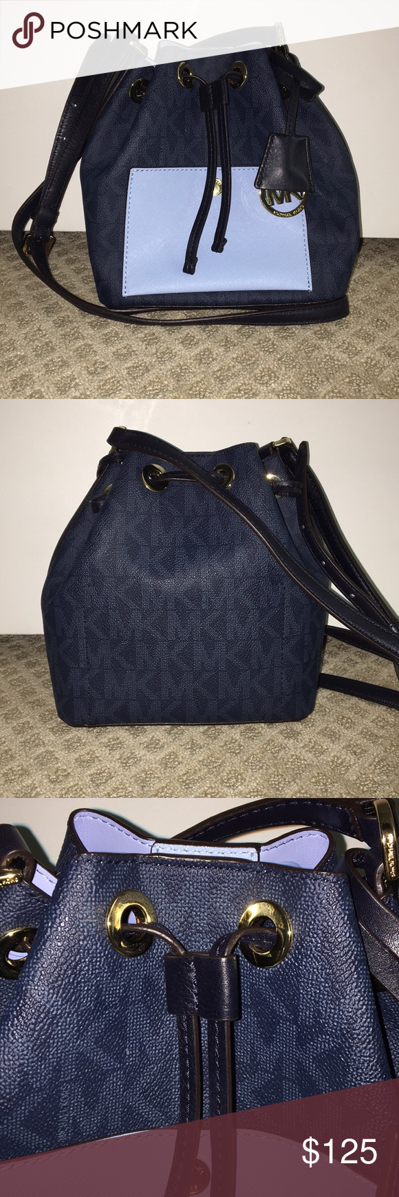 Blue Michael Kors logo bucket crossbody Navy and light blue Michael Kors logo bucket crossbody bag. Drawstring with magnet to open and close with an outside button pocket and one pocket inside. 9in wide 3.5 in depth 8in high. Adjustable strap is about 40 in total. Never worn and still with plastic on bottom of bag and comes with cloth bag. Michael Kors Bags Crossbody Bags