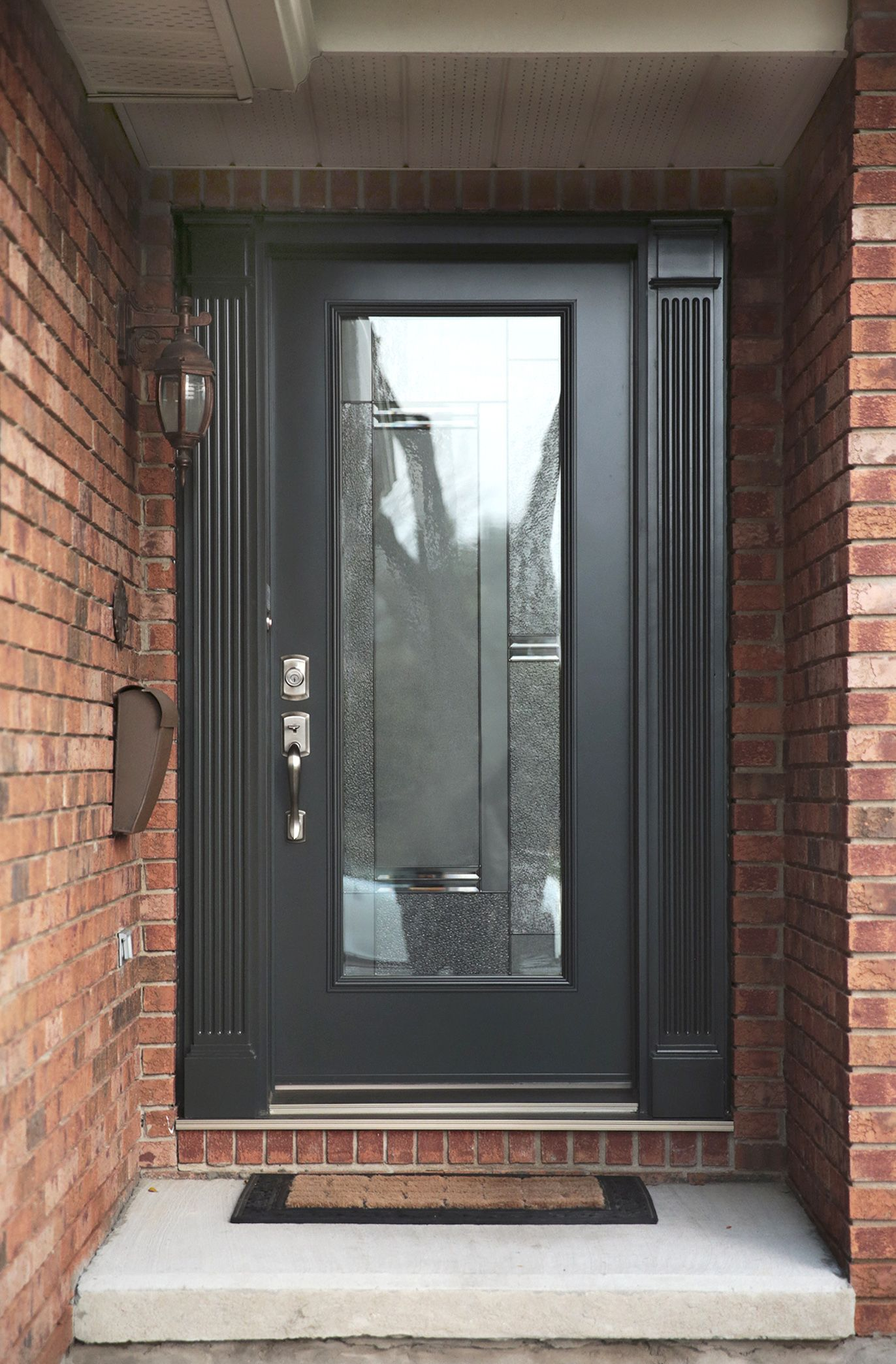 Modern grey front door with full glass insert