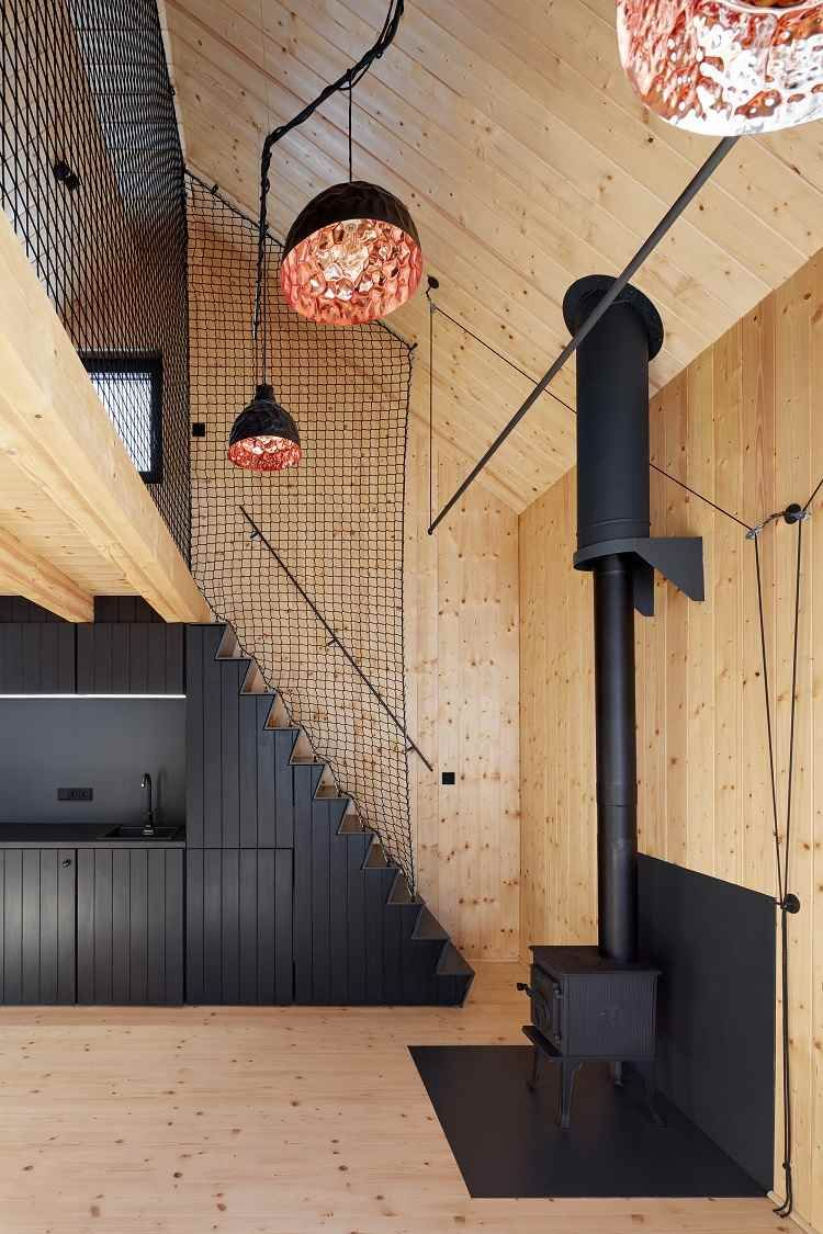 Le bardage bois intérieur d'un refuge au sein de la