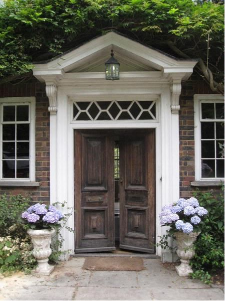 Love the pediment and the glass over the old wooden doors for Glass door design jobs