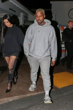Kanye West Wearing Adidas Yeezy Boost 350 V2 Cream Black Stripe Sneakers And Champion Powerblend Retro Fleece Celebrity Style Men Kanye West Style Mens Fashion
