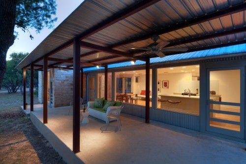 Deep Porches Wide Windows Simple Materials Concrete Galvanized Metal Stone And Glass Covered Patio Design Patio Design Contemporary Patio