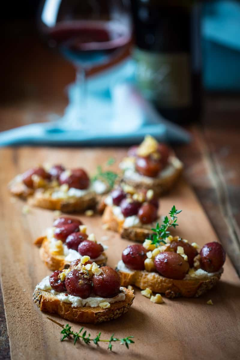 Roasted grape crostini with goat cheese and waluts