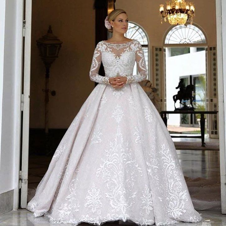 c11bc5a6 This illusion neckline wedding gown has beautiful embellished long sleeves.  We can recreate this design for you for a great price.