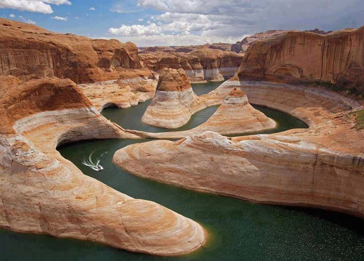 Glen Canyon is located in southeastern and south central Utah and northwestern Arizona within the Vermilion Cliffs area. It was carved by the Colorado River and is a popular destination for hiking, fishing, boating, and jet skiing.