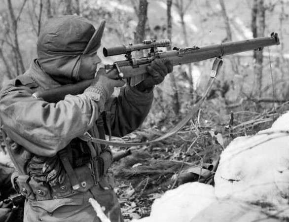 US Marine fooling around with a Lee Enfield sniper rifle