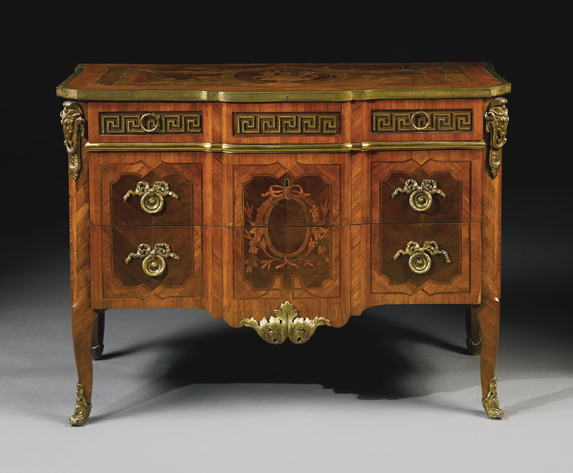 A Dutch early neoclassical ormolu-mounted tulipwood, mahogany and marquetry commode in the manner of Matthijs Horrix - circa 1770.