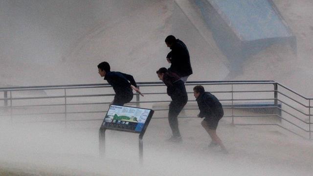 Braving the brutal winds at Bondi. (AAP)