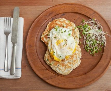 Mushroom leek pancakes with fried eggs and sprouts
