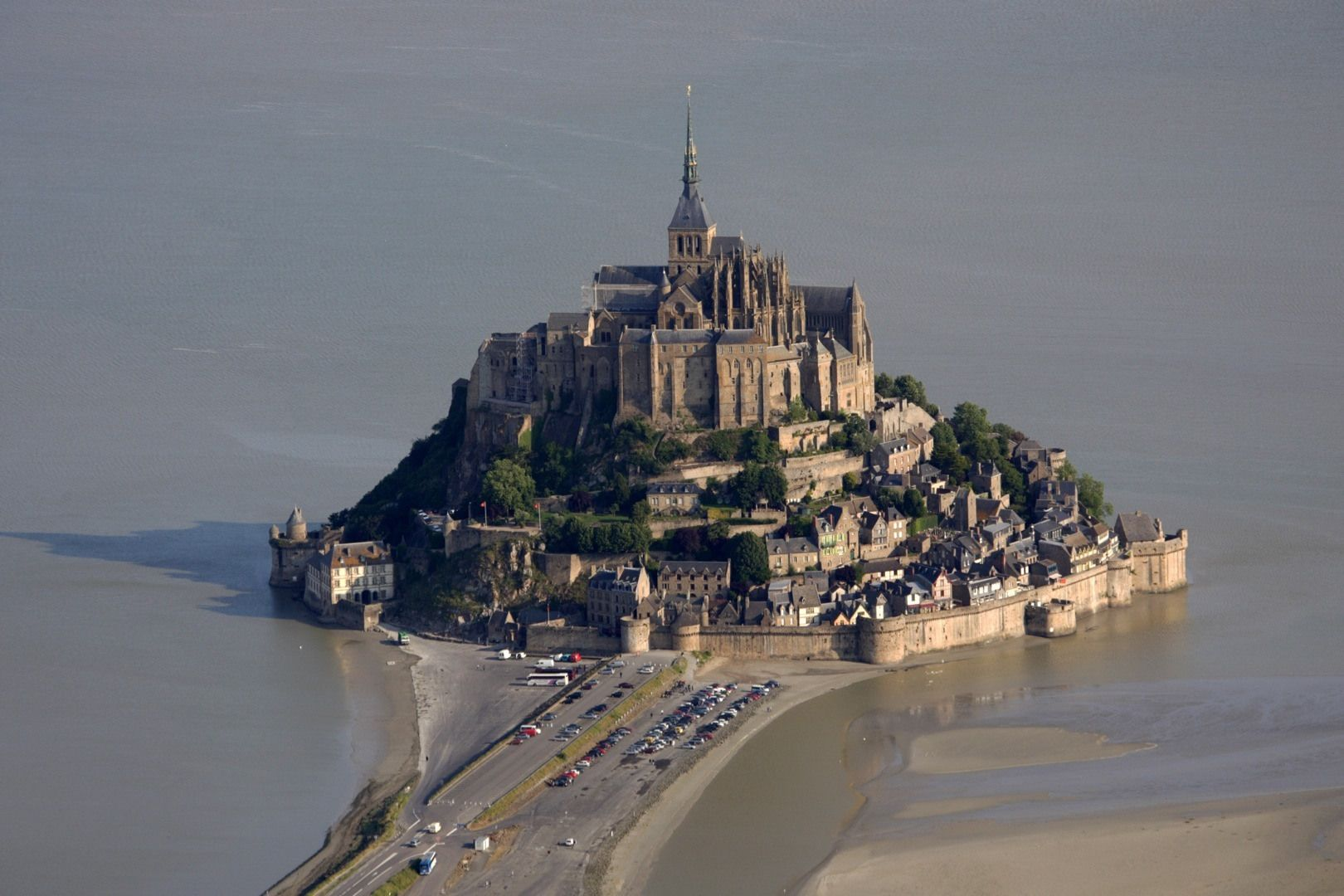 Mont Saint-Michel is a rocky tidal island and a commune in Normandy, France. It is located approximately one kilometre (just over half a mile) off the country's north coast, at the mouth of the Couesnon River near Avranches.