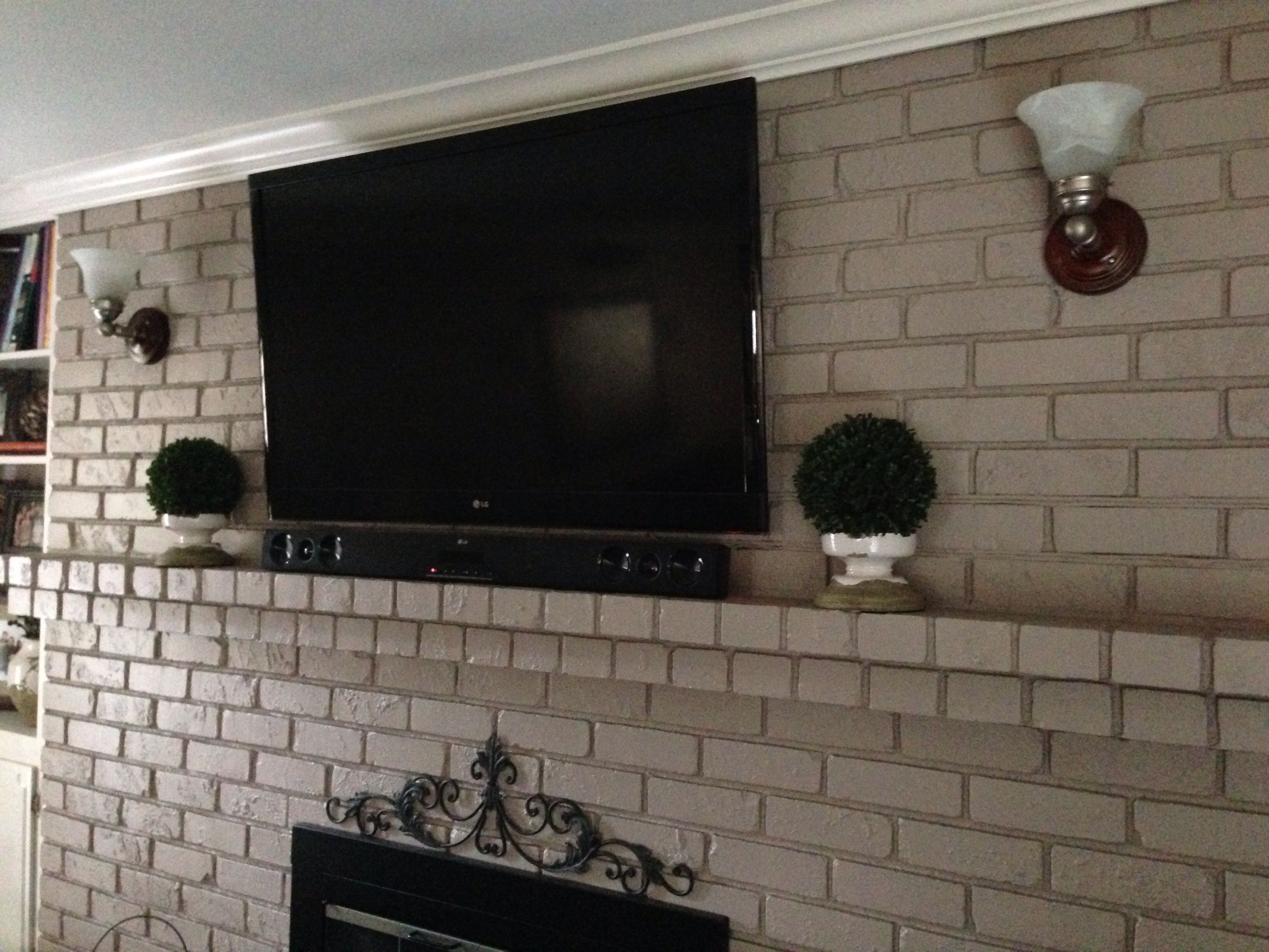 Yes You Can Mount Your Tv To Brick Fireplace Without The Wires Flat Screen Above Wiring Showing Are Siliconed Into Mortar Joints Painted Over