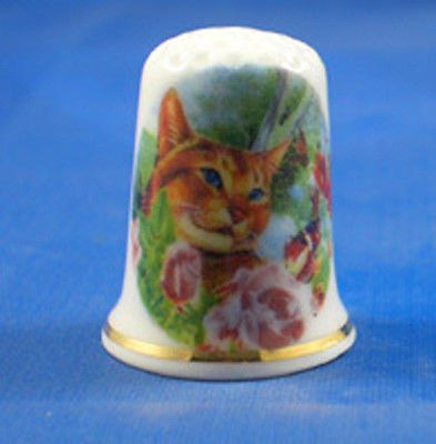 BIRCHCROFT PORCELAIN CHINA THIMBLE MARMALADE CAT IN FLOWERS.