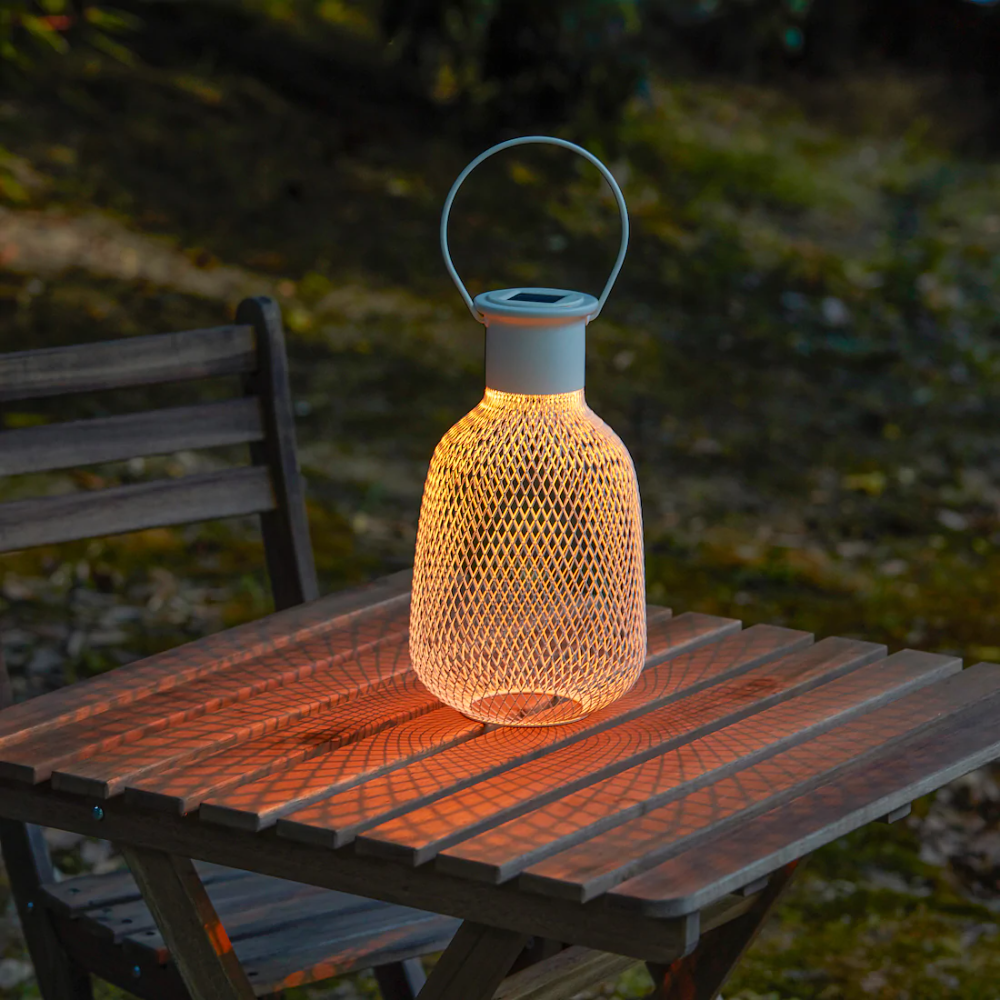 Solvinden Led Solar Powered Lantern Outdoor Mesh White Ikea In 2020 Solar Powered Lanterns Solar Powered Lights Outdoor Solar Lanterns