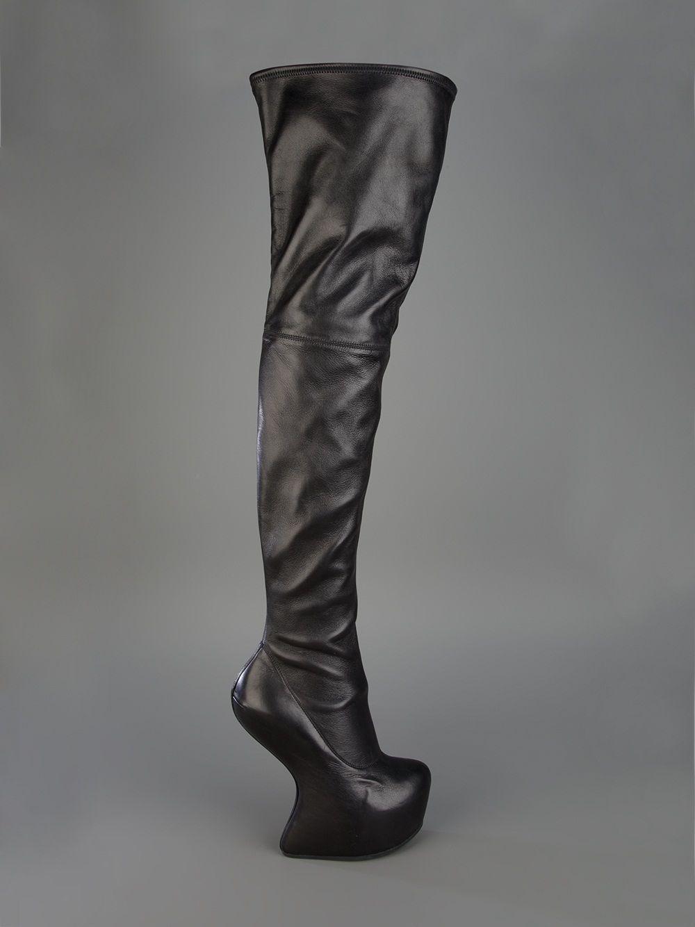 4da83a643328 Black leather thigh high boot from Giuseppe Zanotti design featuring an  almond toe