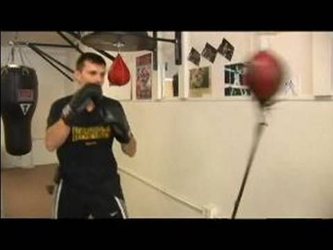 Practicing Boxing On A Double End Bag Practicing In Intervals On A Double End Punching Bag Punching Bag Boxing Workout Boxing Techniques