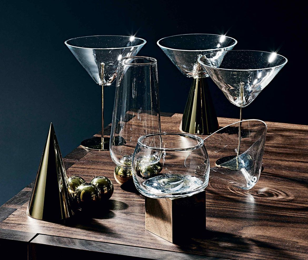 To create a perfect cocktail set, we worked with French glass artist Vanessa Mitrani. For Wallpaper* Handmade 2015, we asked her to use her vases and centrepieces as the starting point for sculptural drinking vessels. The resulting collection includes tumblers, highballs and martini glasses, each perched on a brass base in a range of shapes, from solid cubes and sets of metal spheres to precarious cones and ultra-thin sticks. Shop it now at www.store.wallpaper.com