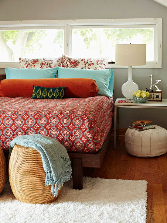 Love everything here but the bedding. So, all the little touches - pouf, nightstand styling, footstools at the end of the bed, wall color.