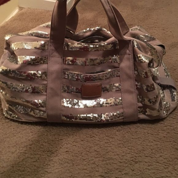 VS pink grey sequin overnight bag VS pink grey sequin overnight bag, gently used but in great condition, no staining or sequins missing Victoria's Secret Bags Travel Bags