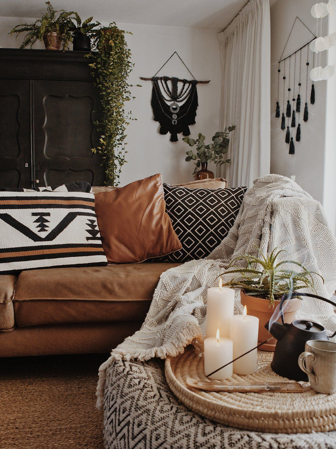 light colors uncluttered lots of pillows and blankets