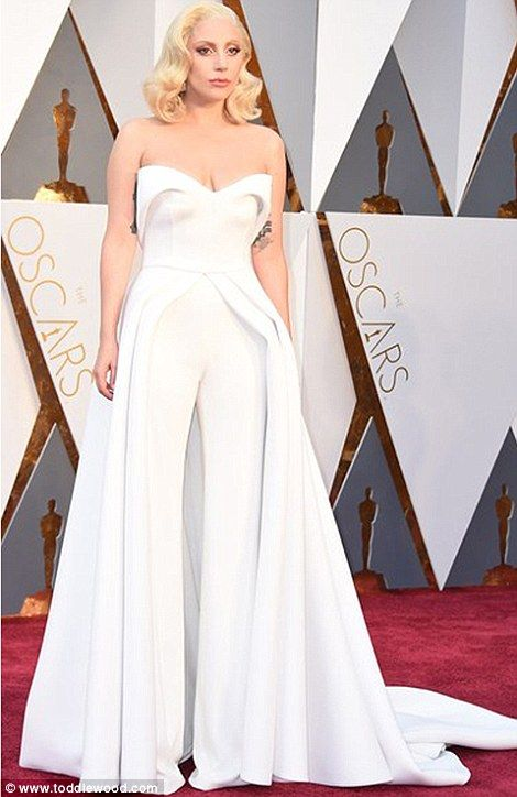 ae4236a9f5a Tip to toe  This gorgeous tiny model was draped in white fabric just like Lady  Gaga was in.