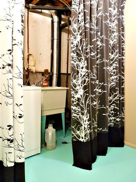 Hide An Unfinished Laundry Room With Paint Fabric