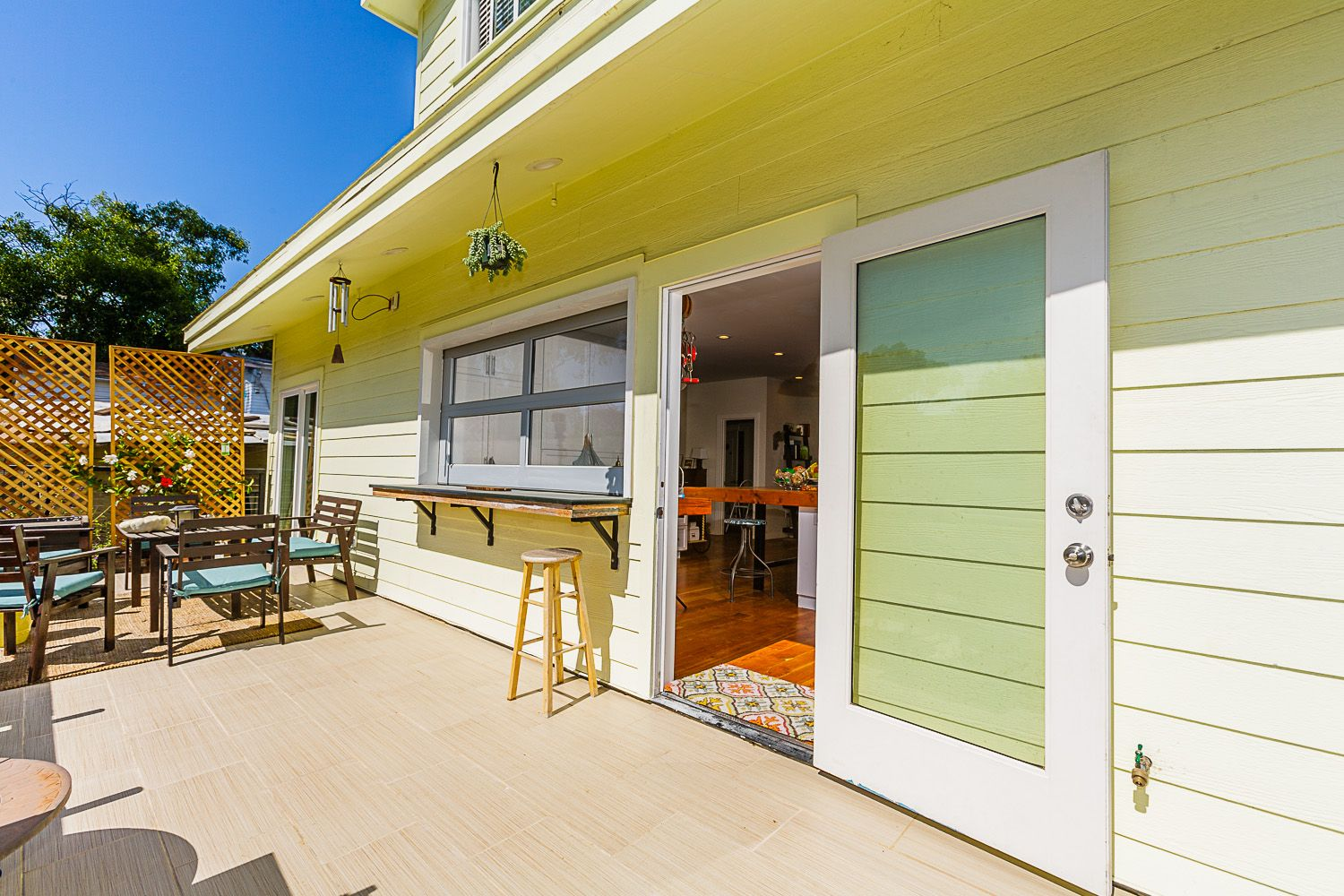 Bright and spacious porch with roll-up kitchen window at 1838 32nd Street
