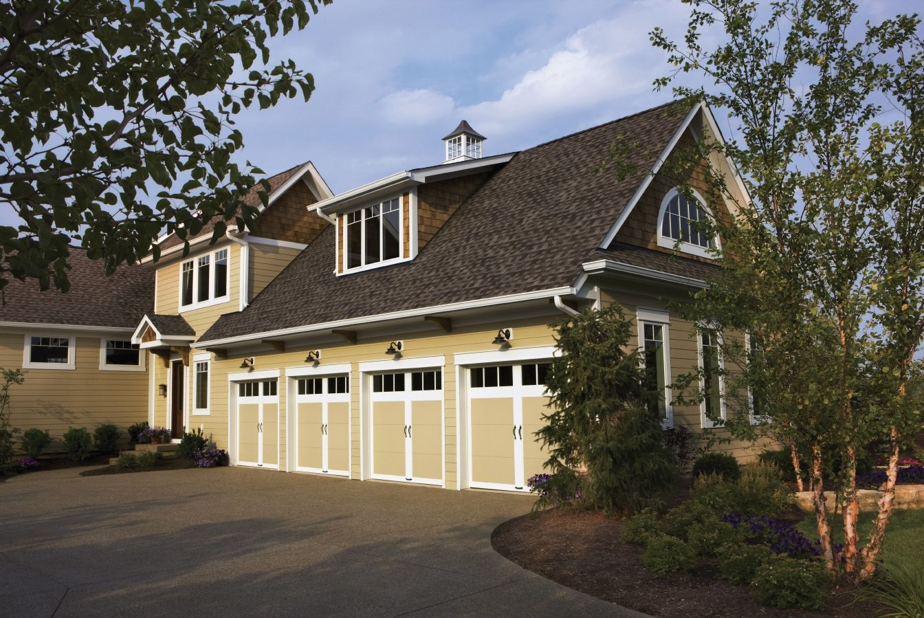 Simple Clean Lines For A Coastal Carriage House Garage Or A Craftsman Home Clopay Coachman Colle Carriage House Doors Garage Doors Carriage House Garage Doors