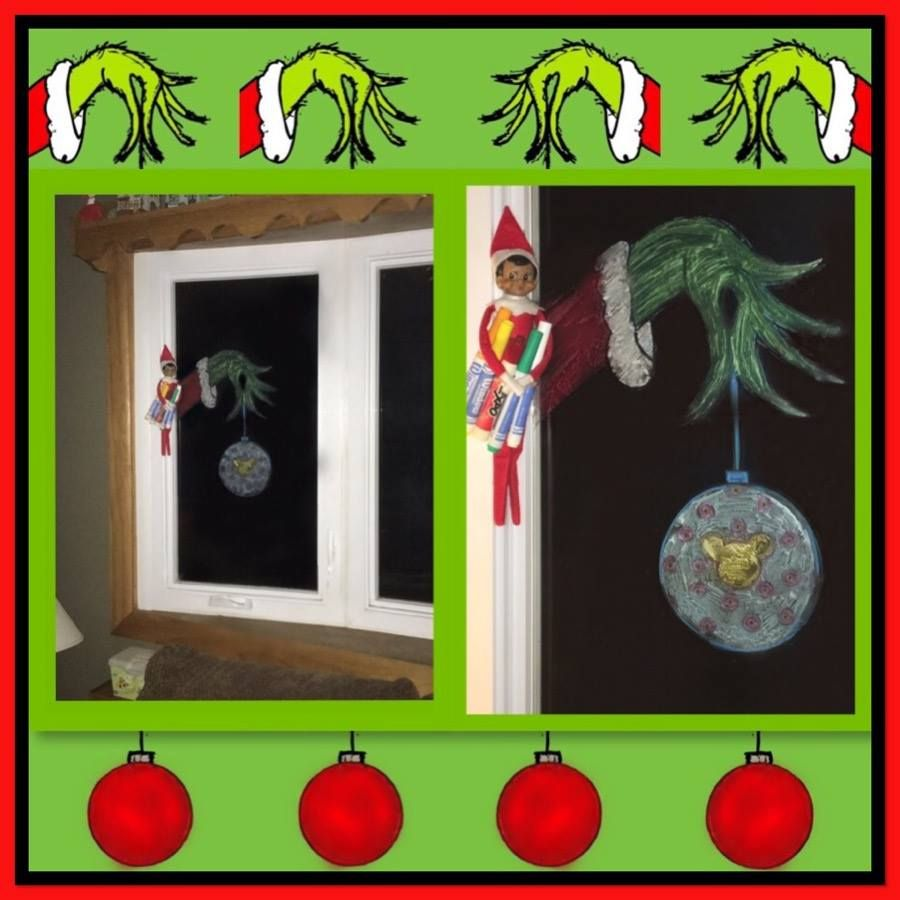 Our Elf Is Quite The Artist He Used Some Window Markers To Draw The Grinch S Hand Holding A Mickey Ornament Christmas 2015 Grinch Hands Elf Drawings