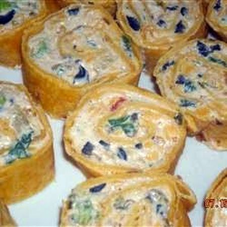 Fiesta Pinwheel Appetizers. I'd replace the olives with black beans!