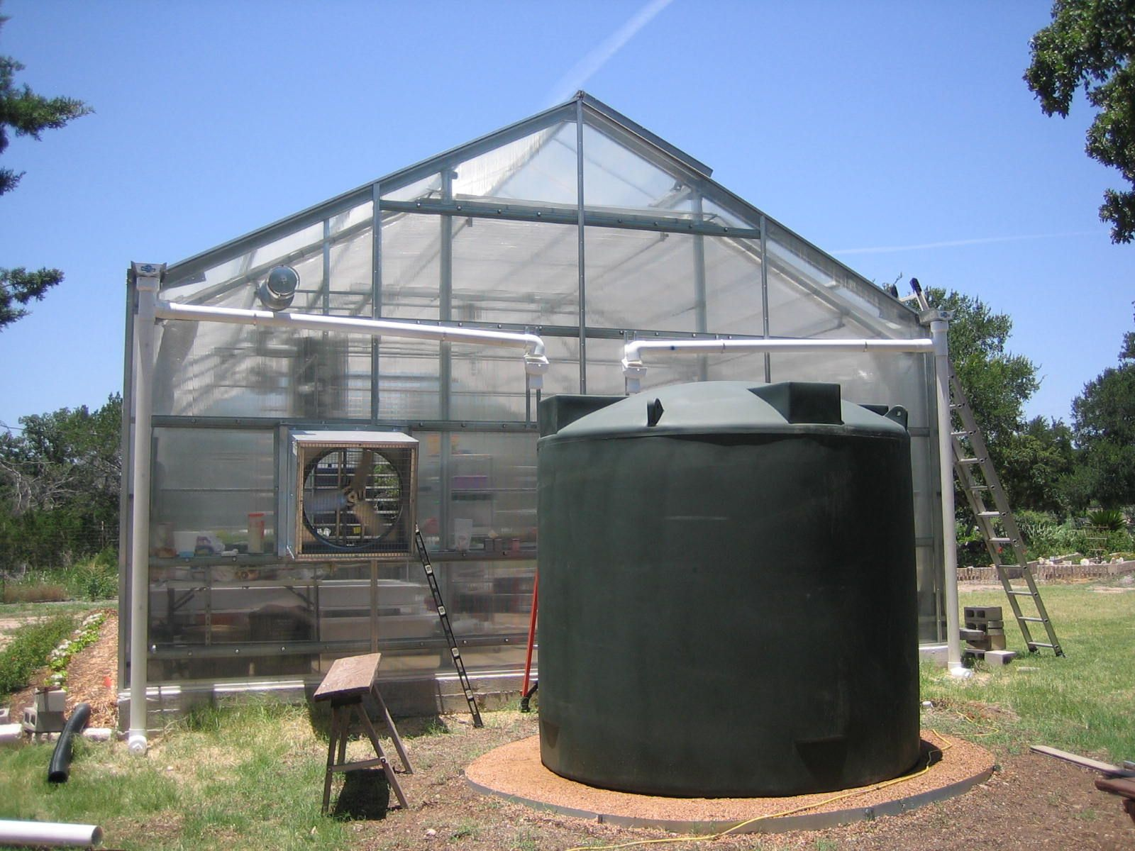 2500 Gallon Poly-Mart Rainwater Tank collecting of of both