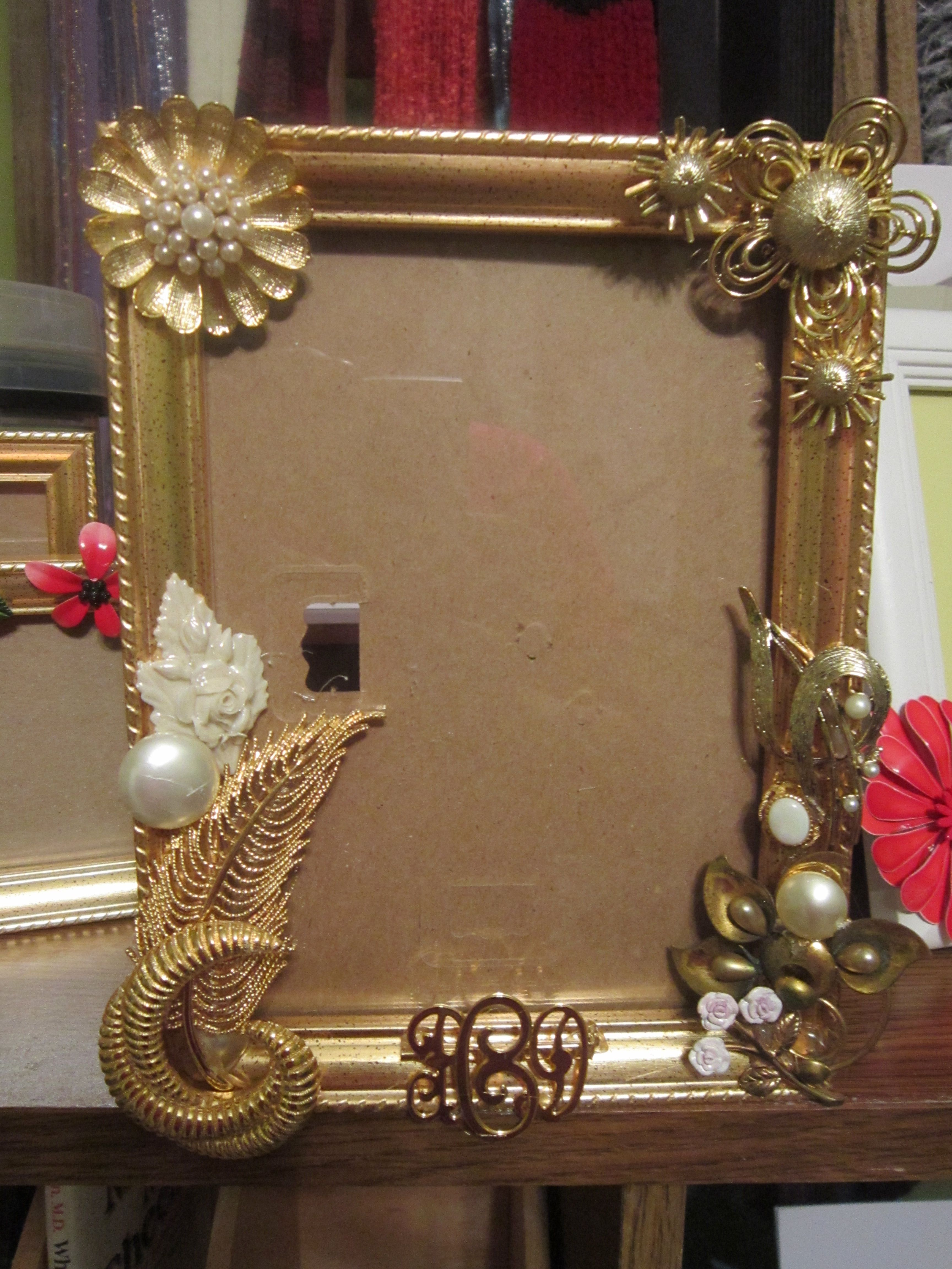 I took my moms old broaches and matching earrings and glued them to a frame ...made one for all of her grandchildren
