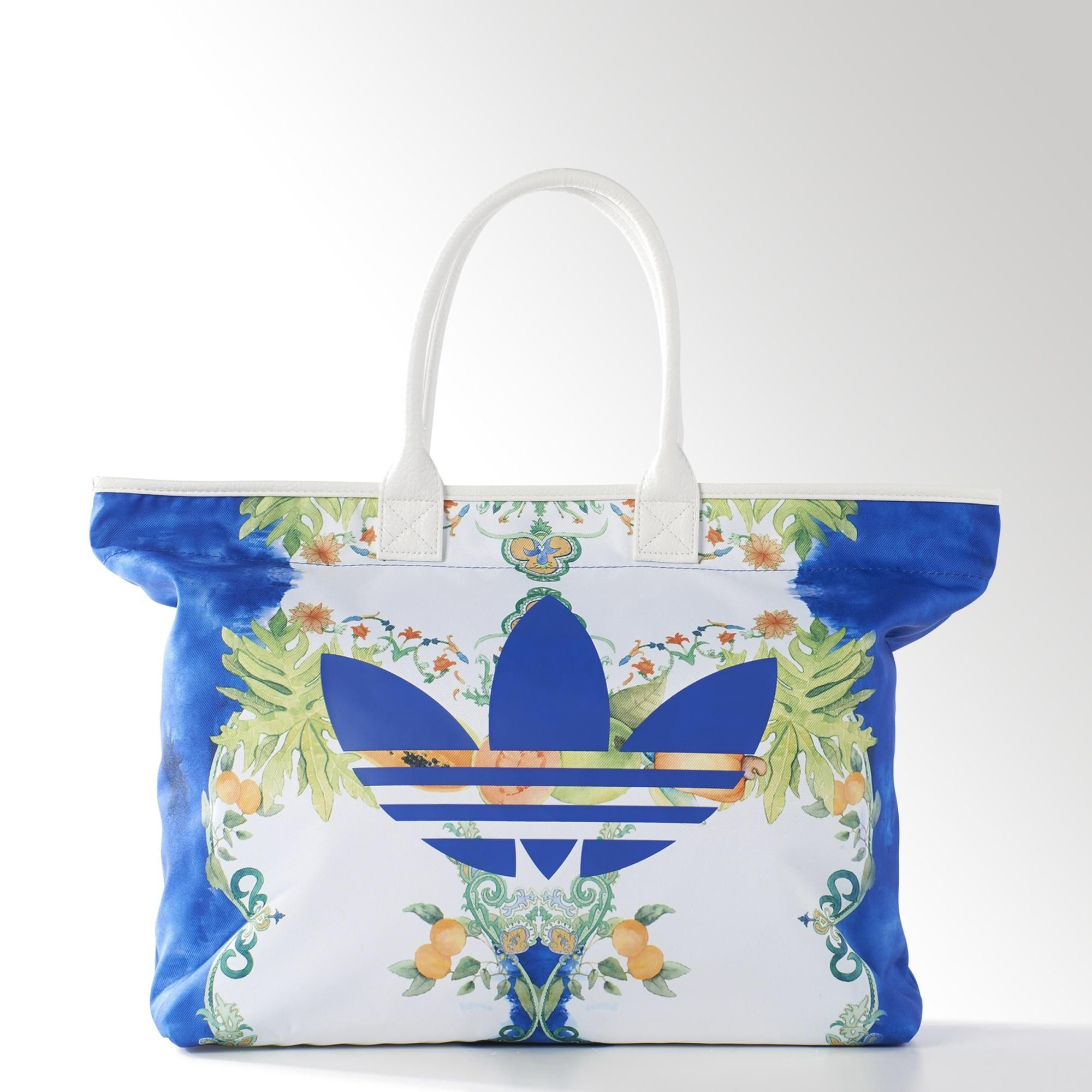 This women s shopper bag puts the Trefoil against a backdrop of delectable  fruits and flowers 644ff355d6d1e